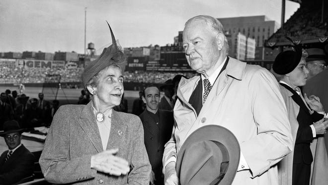 Mrs. Grace Coolidge, widow of the late President Calvin Coolidge, and ex-President Herbert Hoover exchange greetings at Yankee Stadium in New York on Oct. 6, 1949, before the second game of the World Series between the New York Yankees and Brooklyn Dodgers.