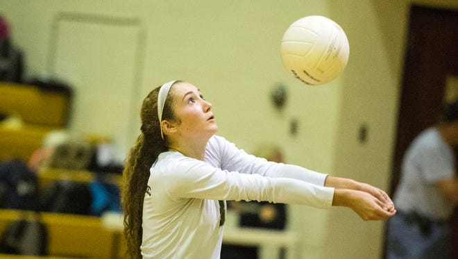 Junior libero Lauren Trummer gets set to pass the ball during Delone Catholic's 3-game win over York Catholic, Thursday, October 5, 2017. The Delone Catholic Squirettes have depended on depth this season, helping the team stay in the No. 1 spot in YAIAA Division III standings.