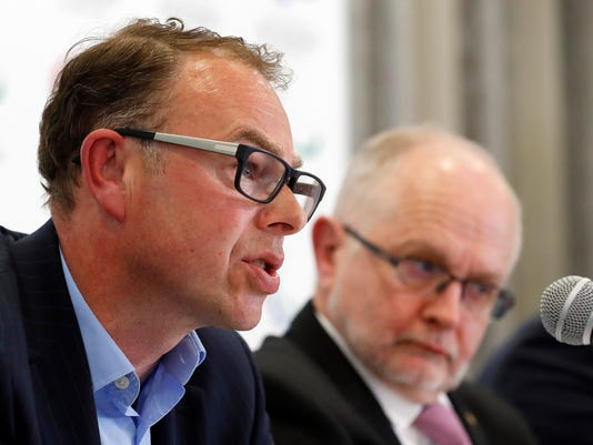 """International Paralympic Committee (IPC) President Philip Craven, right, listens to Andrew Parkinson, an independent chairperson of the IPC taskforce, during a press conference, in London, Monday, May 22, 2017. The International Paralympic Committee says there is a """"strong chance"""" that Russia will be banned from the 2018 Winter Paralympics in Pyeongchang because of the country's doping scandal. (AP Photo/Frank Augstein)"""