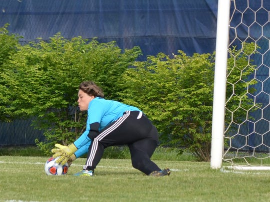 Marshall keeper Maddie Reynolds makes a save during the Redhawks' 1-0 win.