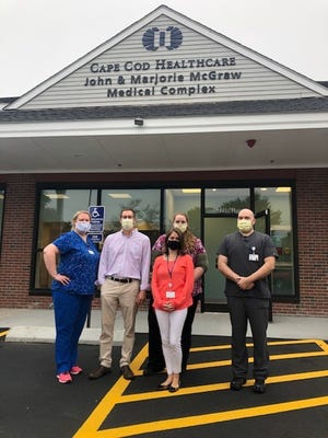 The Osterville Primary Care team, from left, includes: Kate Mullane, RN;  Matthew Rittel, MD; Liz Robbins (front); Rebekah Stallings, RN; and Domingo Monzon, RN.