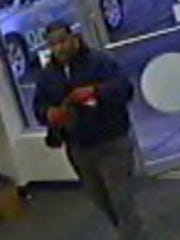 Police have released photos of a man they said robbed a Delta Township cash advance store at knife-point Monday evening, Eaton County sheriff's officials said.