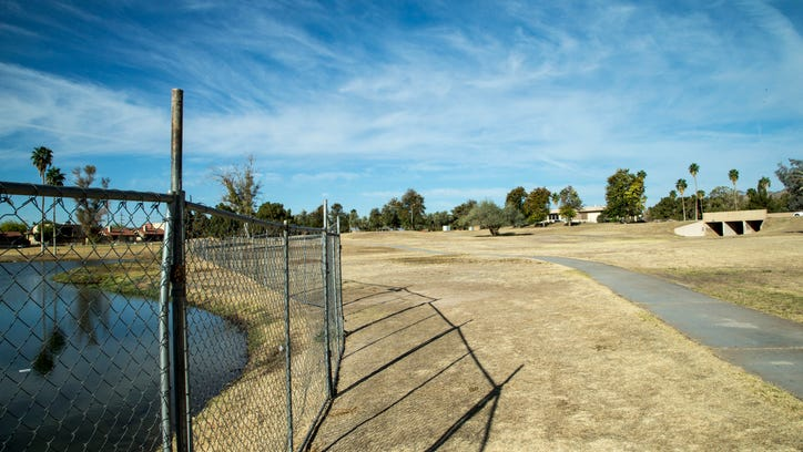 Shuttered Ahwatukee Lakes Golf Club, located at 13431 S. 44th St., Phoenix, was surrounded by barbed wire and chain-link fencing on Monday, April 14, 2014.