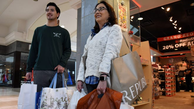 Black Friday shoppers Diane Pinkard and her son Connor with their haul from West Town Mall Friday, Nov. 24, 2017.