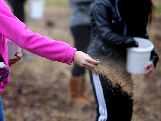 Whitnall Middle students cast Oak Savannah seeds