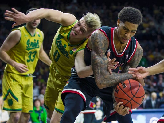 Notre Dame's Rex Pflueger (0) and Louisville's Ray Spalding (13) fight for a rebound during an NCAA college basketball game, Tuesday, Jan. 16, 2018 in South Bend, Ind. (Michael Caterina/South Bend Tribune via AP)