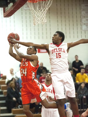 Cumberland's Kyonn Bragg, left, shoots as Delsea's Rodney Price defends during the 1st quarter of the first round Group 3 boys basketball playoff game  played at Delsea High School on Tuesday.  02.28.17