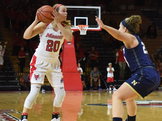 Marist College's Hannah Hand looks to make a move against a Navy defender during the 2017-18  season-opener. She missed all of 2018-19.