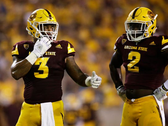 Arizona State's (3) DJ Calhoun and (2) Christian Sam.