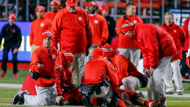The Rutgers medical staff tended to an injured Derrick Nelson on the field last season after a helmet-to-helmet collision with teammate Dorian Miller.