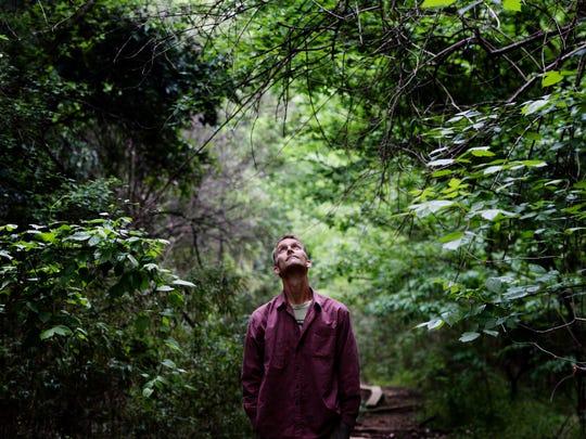 Jon Soul stands in Coates Bluff Nature Trail in Shreveport.