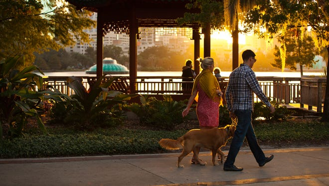The trail around Lake Eola is a scenic, mile-long must-see in downtown Orlando.