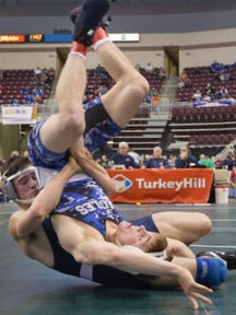 Eastern York senior Dakota Mackley, left, is seen here taking down 2015 state champion Jake Wentzel in last year's PIAA Class AA tournament. Mackley is competing in this weekend's Class AA regional tournament with a spot in the state tournament on the line.