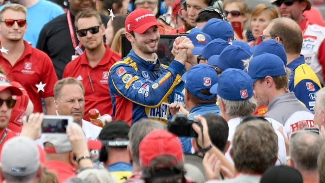 Alexander Rossi accepts congatulations from the team after winning the Honda Indy 200 on Sunday at the Mid-Ohio Sports Car Course.