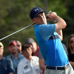 Jordan Spieth hits his tee shot on the 18th tee Thursday during the first round of The Masters at Augusta National Golf Club.