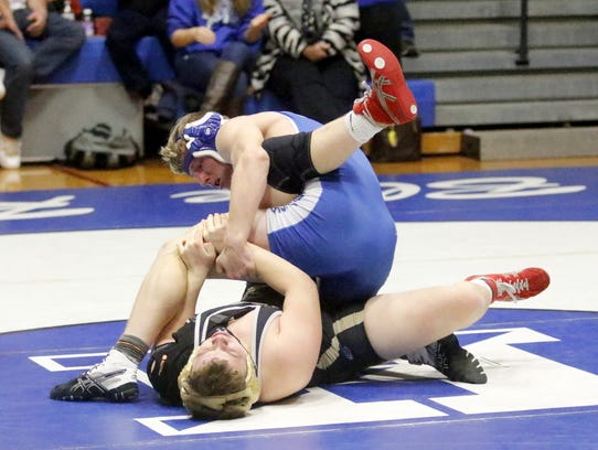 Chris Eames of Horseheads, top, has control against