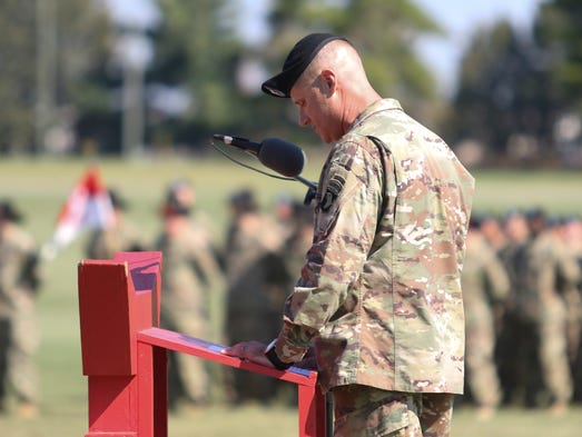 Col. Larry Burris speaks during the color casing ceremony