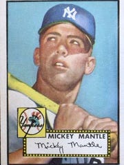 A 1952 Mickey Mantle Topps rookie card recently sold