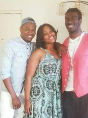 Dimere Young (right) is pictured with his brother, Devonte Young, and his sister, Jalita Henry.