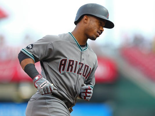 Arizona Diamondbacks' Jean Segura runs the bases after hitting a solo home run off of Cincinnati Reds' Dan Straily in the first inning of a baseball game, Friday, July 22, 2016, in Cincinnati. (AP Photo/Aaron Doster)
