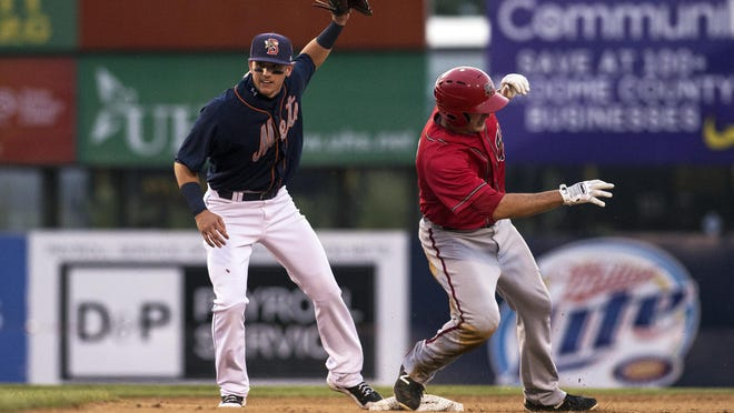 Binghamton Mets shortstop Gavin Cecchini tags out Shawn Pleffner of the Harrisburg Senators during a game on Thursday, June 25, 2015 at NYSEG Stadium.