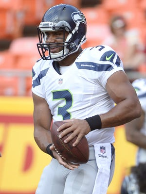 Seattle Seahawks quarterback Russell Wilson (3) warms up prior to the game against the Kansas City Chiefs at Arrowhead Stadium.