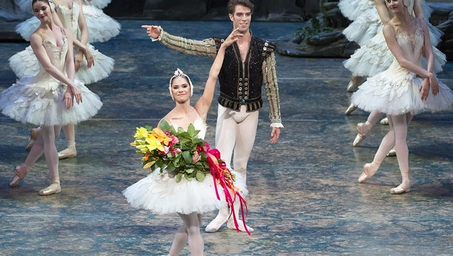 """Misty Copeland and James Whiteside acknowledge the audience after appearing in """"Swan Lake"""" at the Metropolitan Opera House in New York on June 24, 2015."""