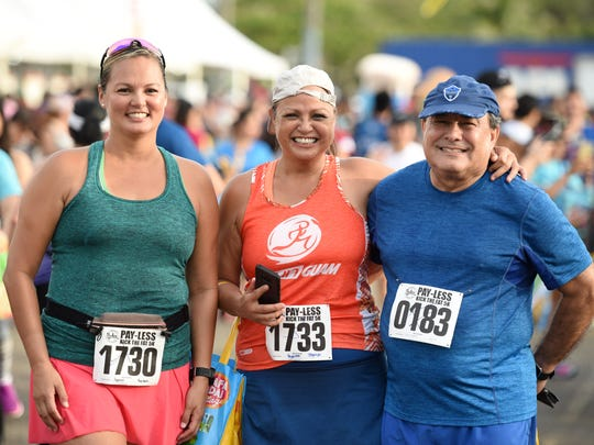 A group photo seemed to be a favorite of the morning as participants celebrate completing the 22nd annual Pay-Less Kick the Fat 5K Run/Walk in Hagåtña on March 24, 2018.