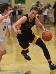 Galena's Moses Wood drives to the basket against Manogue's Brayden De Bruin during Tuesday's game at Bishop Manogue.