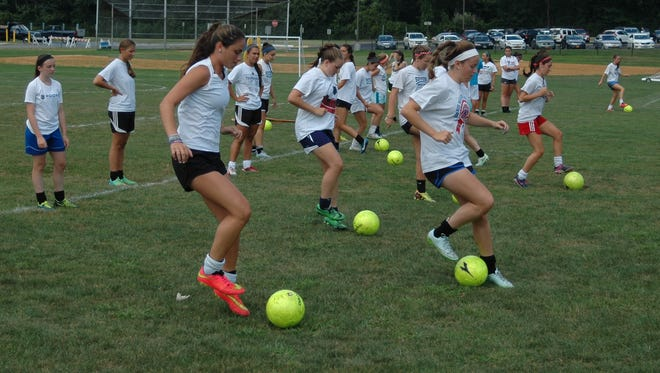 Suffern's girls soccer teams warms up for an afternoon pre-season practice session at Suffern High School on August 25, 2015.