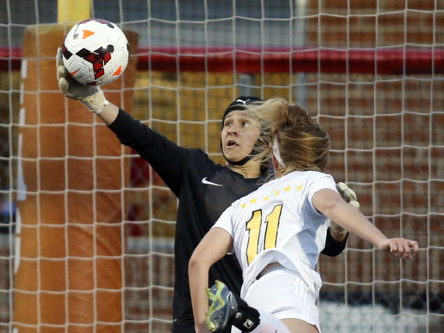 Caesar Rodney goalie Marianna Nuzzo makes a save on a point-blank header from Padua's Anne Brush in the first half of the DIAA Division I state title game at Smyrna High School on Friday.