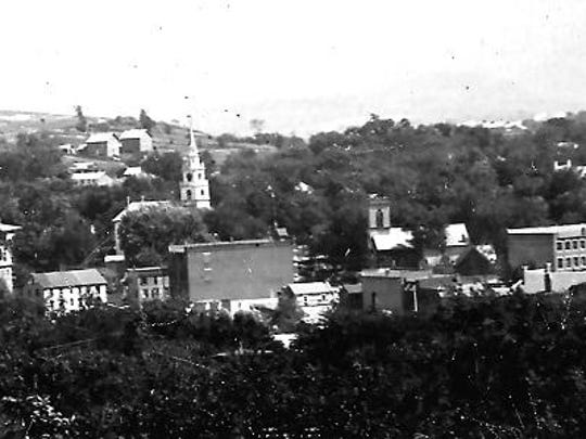 View of Middlebury Village, c. 1900. Chipman Hill to left, Green Mountains in the distance.