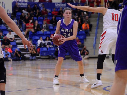 Wylie's Mary Lovelace (24) looks to make a pass during the Lady Bulldogs' 51-48 win against Levelland in the Region I-4A semifinals last season. On Friday she got her senior season off to a hot start scoring 20 points leading Wylie past Abilene High 71-38.
