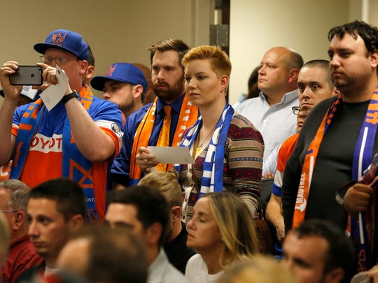 FC Cincinnati supporters fill the chambers during a County Commissioners meeting at the Hamilton County Board of Elections in Norwood, Ohio, on Tuesday, Sept. 26, 2017. The Commissioners met to discuss the future of projects in the county, including a new soccer stadium, rebuild of US Bank Arena and repairs to the Western Hills Viaduct.