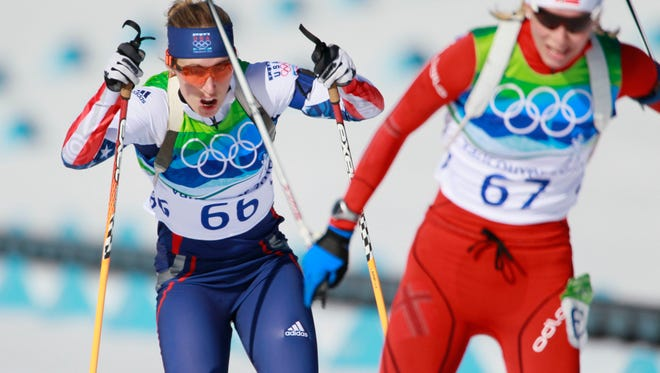 In a file photo from 2010, Lanny Barnes (left) competes during the women's 15 KM Individual Biathlon event at the Whistler Olympic Park at the 2010 Vancouver Olympics in Whistler, B.C.