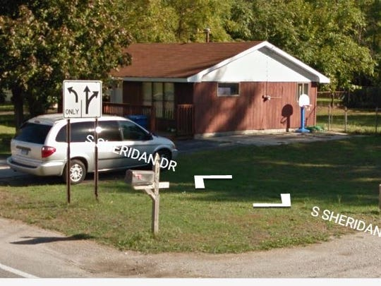 An undated Google Street Images photo shows a silver minivan parked outside Jeffrey WIllis' house on South Sheridan in Muskegon Township.