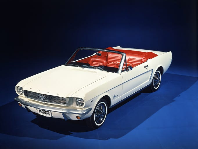 The original 1965 Ford Mustang convertible in Wimbledon White -- the early version known to many as the 1964  1/2. Mustang went on sale on April 17, 1964 and sold more than 418,000 in the first 12 months.