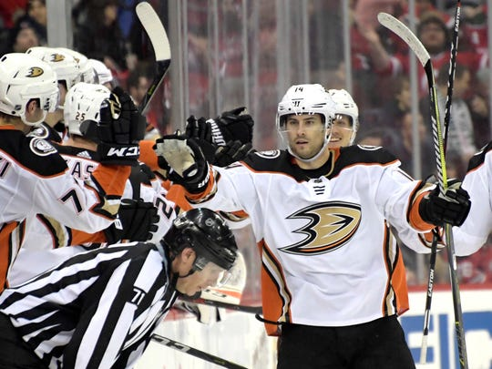 Anaheim Ducks center Adam Henrique (14) celebrates his goal during the second period of Monday's game in Newark.