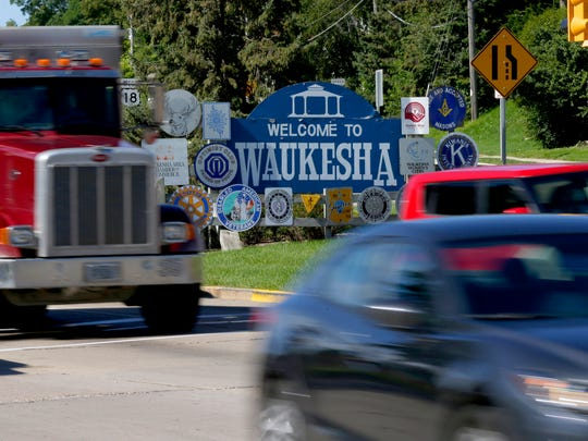 A welcome to Waukesha sign sits in the boulevard of