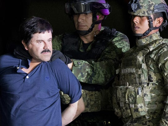 "FILE - In this Jan. 8, 2016 file photo, a handcuffed Joaquin ""El Chapo"" Guzman is made to face the press as he is escorted to a helicopter by Mexican soldiers and marines at a federal hangar in Mexico City. Mexico's most notorious cartel kingpin who twice made brazen prison escapes and spent years on the run as the country's most wanted man, was extradited to the United States on Thursday, Jan. 19, 2017, to face drug trafficking and other charges."