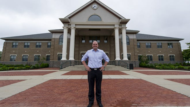 Town Manager Scott Fadness, shown on May 14, 2014, in front of Fishers Town Hall, has been supportive of using public money, including tax increment financing funds, to partner with developers on projects slated for downtown.