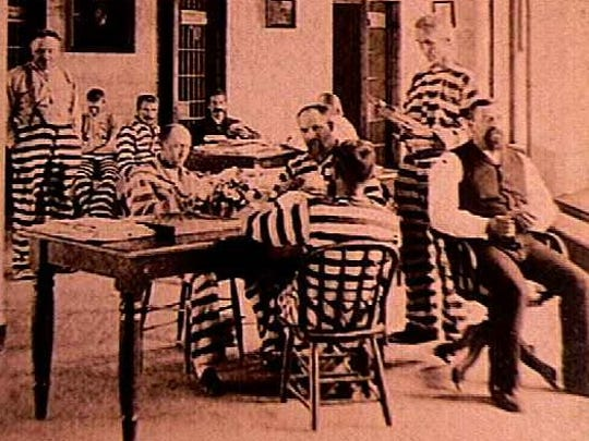 One of the earliest photos of Anamosa prison life taken in the 1880s shows inmates in classic striped uniforms supervised by a vested prison guard.