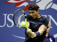 FILE - In this Sept. 2, 2016, file photo, Rafael Nadal, of Spain, returns a shot to Andrey Kuznetsov, of Russia, during the U.S. Open tennis tournament in New York.Nadal is not sure he will try to defend his title — if the Open is held at all. A decision by the U.S. Tennis Association about whether to have its marquee event is expected as soon as next week. (AP Photo/Julio Cortez, File)