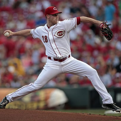 Cincinnati Reds starting pitcher Anthony DeSclafani (28) delivers a pitch in the top of the first inning of the MLB game between the Cincinnati Reds and the St. Louis Cardinals at Great American Ballpark in downtown Cincinnati, on Tuesday.
