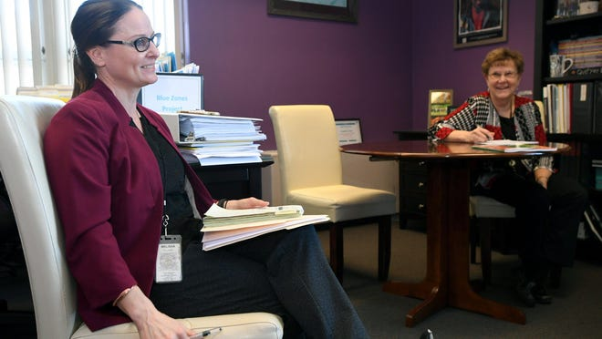 Melissa Lyon, director of the Erie County Department of Health, at left, meets with Charlotte Berringer, background, director of community health services at the health department, and other staffers in Lyon's office on April 3.