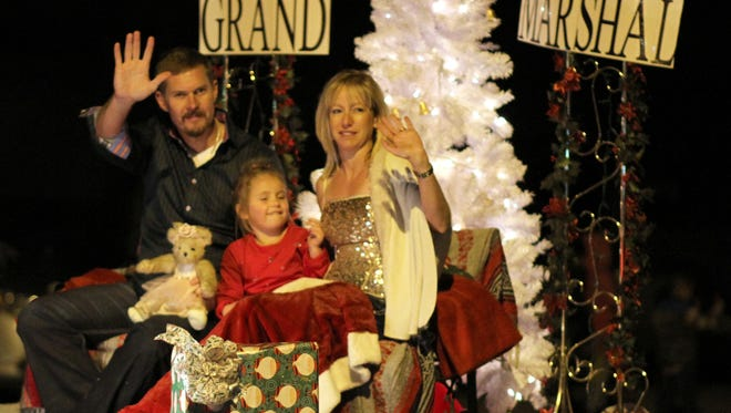 The Stevens Family, Joel, little Maddie and Shannon, were grand marshals for the Kiwanis Christmas Light Parade on Saturday.