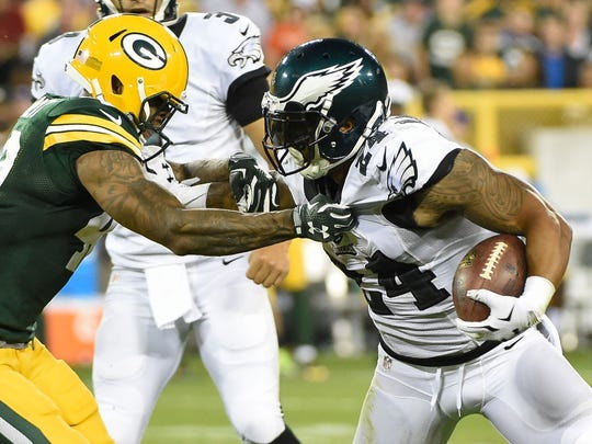 Aug 29, 2015; Green Bay, WI, USA; Philadelphia Eagles running back Ryan Mathews (24) is tackled by Green Bay Packers safety Morgan Burnett (42) in the second quarter at Lambeau Field.