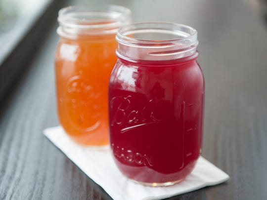 An Orange Hibiscus Kombucha (right) and an Aphrodite (fig and vanilla) Kombucha are served at Heart Beet Kitchen in Westmont.