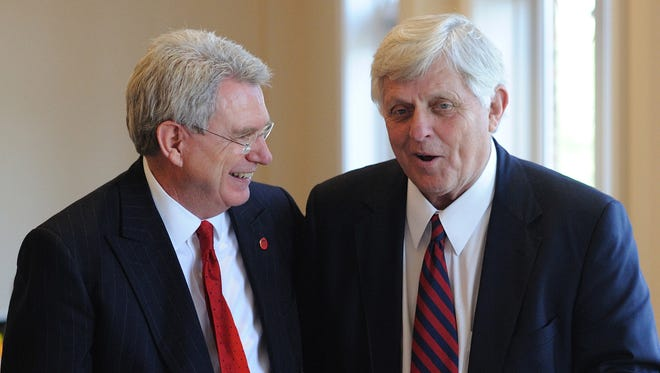 In this 2010 file photo, University of Mississippi Chancellor Daniel W. Jones, left, and Chancellor Emeratus Robert C. Khayat chat at a luncheon honoring Jones on campus in Oxford on April 9, 2010.