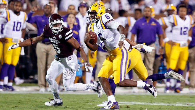 LSU quarterback Brandon Harris (6) tries to elude Mississippi State defensive back Cedric Jiles (5) on a short run during the second half of an NCAA college football game Saturday, Sept. 12, 2015, in Starkville, Miss. LSU won 21-19. (AP Photo/Rogelio V. Solis)